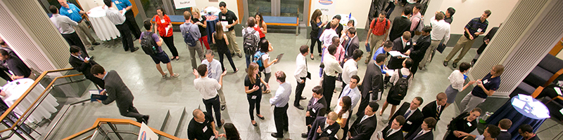 students and company reps at networking event